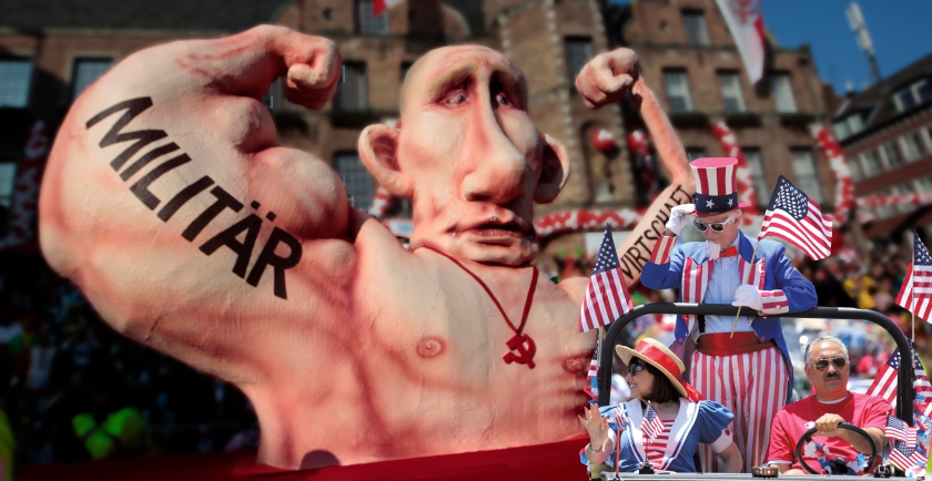 Carnival float with a paper-mache caricature of Russia's President Vladimir Putin drives past revellers during the traditional Rose Monday carnival parade in the western German city of Duesseldorf